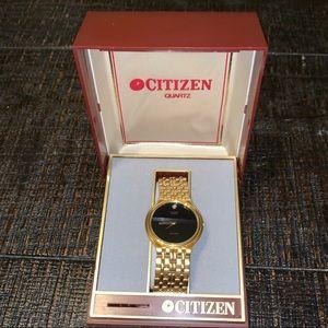 Vintage Citizen Quartz gold watch with black face